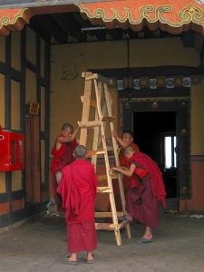 Monks changing a lightbulb